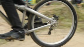 Accelerating BMX to win riding contest spinning pedals, finish. Stock footage stock footage