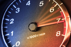 Accelerating Dashboard. Arrow of tachometre in red zone Royalty Free Stock Images