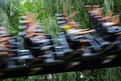 Accelerating roller coaster blur. Blurred image of people speeding by in a hyper-coaster Stock Image