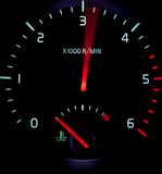 Acceleration -. Close-up view of a revolution counter tachometer while speeding up in a modern car Stock Image