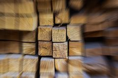 Acceleration abstract wooden background group of beams among blurry building materials highlighted set close-up base stock photo