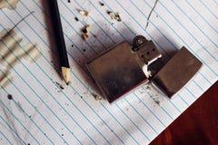Accendino e matita su carta Fotografia Stock Libera da Diritti