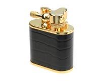 Accenditore dorato della benzina Fotografia Stock