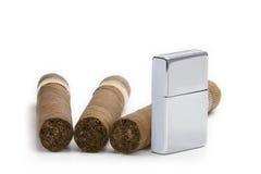 Accenditore e sigaro Fotografia Stock