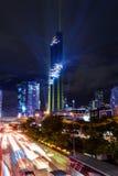Accensione della manifestazione all'alta torre nella città Immagini Stock Libere da Diritti