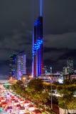 Accensione della manifestazione all'alta torre nella città Immagine Stock Libera da Diritti