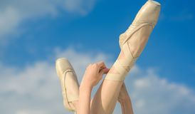 Accentuating the beauty. Ballet slippers. Ballerina shoes. Ballerina legs in ballet shoes. Feet in pointe shoes. Pointe. Shoes worn by ballet dancer. Classic royalty free stock photography