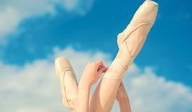 Accentuating the beauty. Ballet slippers. Ballerina shoes. Ballerina legs in ballet shoes. Feet in pointe shoes. Pointe royalty free stock photos
