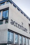 Accenture logo at building in Munich, Germany. MUNICH, GERMANY - DECEMBER 26, 2018: Accenture logo at the company office building located in Munich, Germany royalty free stock photos