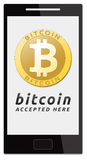 We accept bitcoins. Golden bitcoin virtual currency on mobile phone Stock Images