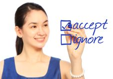 Accept or Ignore?. A woman making her choice Stock Image