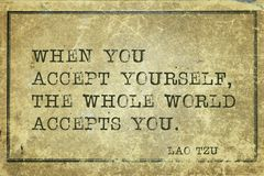 Accept yourself LT. When you accept yourself - ancient Chinese philosopher Lao Tzu quote printed on grunge vintage cardboard Royalty Free Stock Images