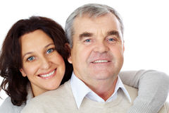 Acceptance. Portrait of happy mature couple looking at camera while woman embracing man Royalty Free Stock Image