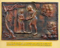 Accepting aims from Chandanbala for breaking fasts of five months and twenty five days with specific vows. Street bass relief on the wall of Jain Temple also Stock Image