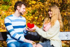 Girl show feelings to man in autumnal park. Royalty Free Stock Photography