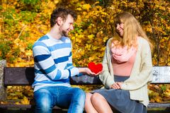 Man show feelings to girl in autumnal park. Stock Images