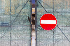 Acces denied sign hanging on a metal fence. Royalty Free Stock Photos