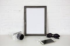 Accesorios ascendentes y modernos de la mofa del blanco del marco Foto de archivo