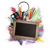 Accesorios de la escuela en el fondo blanco Imagen de archivo libre de regalías