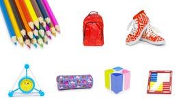 Accesorios de la oficina y del estudiante aislados en un fondo blanco B Imagen de archivo libre de regalías