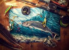 Accesorios de la pesca en la tabla Fotografía de archivo