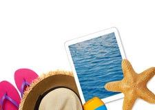Accesorios de la tableta y de la playa Imagen de archivo libre de regalías
