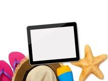 Accesorios de la tableta y de la playa Foto de archivo libre de regalías