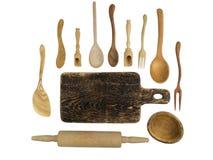 Accesorios de madera de la cocina en un fondo blanco Fotos de archivo libres de regalías