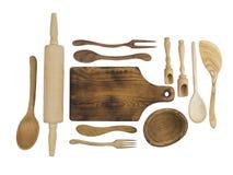 Accesorios de madera de la cocina en un fondo blanco Imágenes de archivo libres de regalías