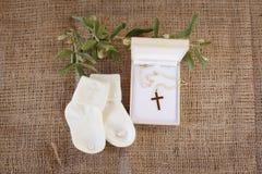 Accesorios del bautizo Imagen de archivo libre de regalías