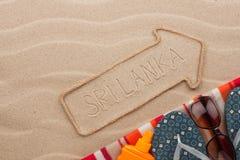 Accesorios del indicador y de la playa de Sri Lanka que mienten en la arena Foto de archivo