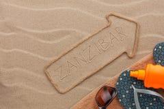 Accesorios del indicador y de la playa de Zanzíbar que mienten en la arena Fotos de archivo