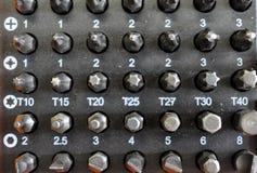 Accesorios del metal para apretar los tornillos Imágenes de archivo libres de regalías
