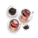Accesorios del té en un fondo blanco Fotos de archivo