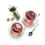 Accesorios del té en un fondo blanco Imagenes de archivo