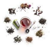 Accesorios del té en un fondo blanco Foto de archivo libre de regalías