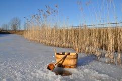 Accesorios para el baño ruso cerca del agujero del hielo Fotografía de archivo libre de regalías