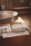 Accesorios para el bautizo baño en la fuente bautismal Imagen de archivo libre de regalías