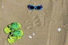 Accesorios para el bebé de la playa Fotografía de archivo