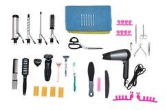 Accesorios para el cuidado y el peinado estéticos en el fondo blanco Foto de archivo libre de regalías