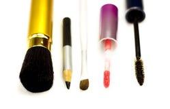 Accesorios para el maquillaje en un fondo blanco Foto de archivo libre de regalías