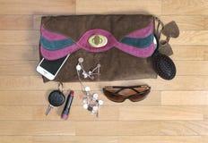 Accesorios personales del bolso Foto de archivo libre de regalías