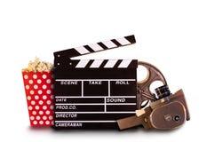 Accesorios retros de la producción de la película en el fondo blanco Fotografía de archivo