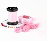 Accesorios rosados de costura Fotografía de archivo libre de regalías