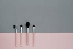 Accesorios rosados grises de los cosméticos del fondo Imágenes de archivo libres de regalías