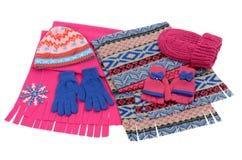 Accesorios rosados y azules del invierno aislados en el fondo blanco Imagenes de archivo