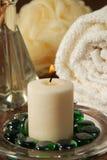 Accesorios votivos de la vela y del balneario Foto de archivo