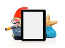 Accesorios y tableta de la playa Imagen de archivo