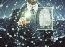 Access and biometrics concept. Businessman pointing at abstract digital finger print hologram on city background. Access and biometrics concept. Double exposure Stock Photo