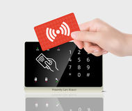 Access control - Proximity card and reader. Proximity reader with RFID card in hand Stock Images